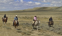 Riding in Wyoming with blue Sky Sage Adventures