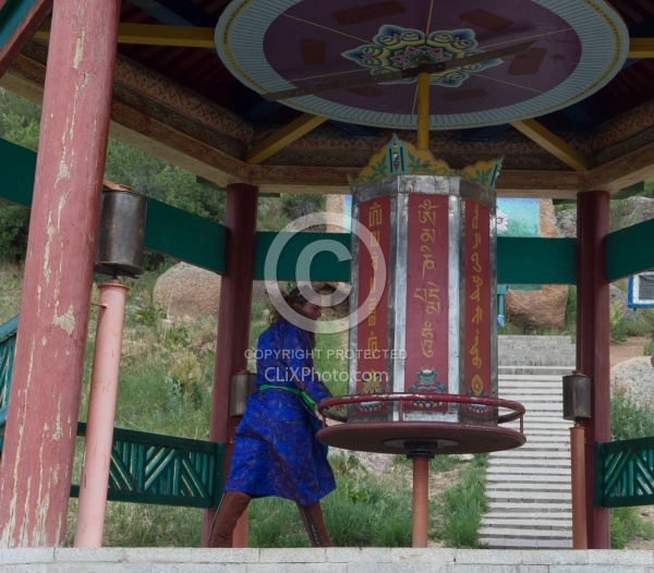 Shawn turning the wheel at the Buddhist Monastery