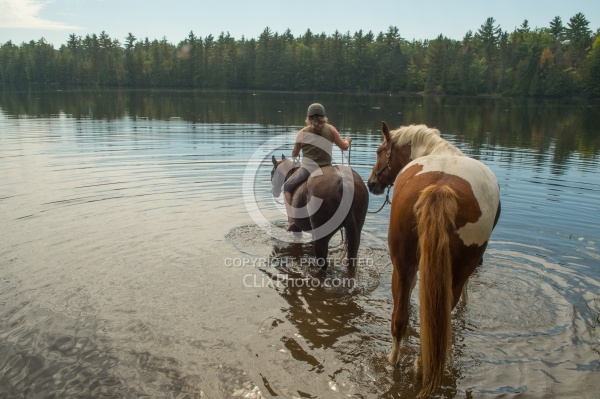 Shawn on Bailey Boy Leading Major into the Water at Voyaguer Bay Ponying a Horse to Water